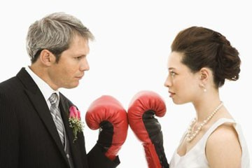 Husband and wife ready for boxing fight match.